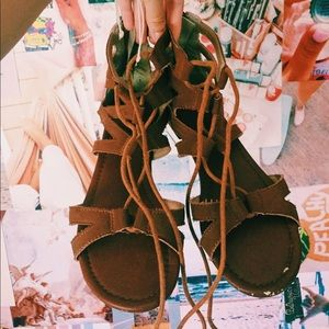 Celebrity pink brown suede laced up sandals